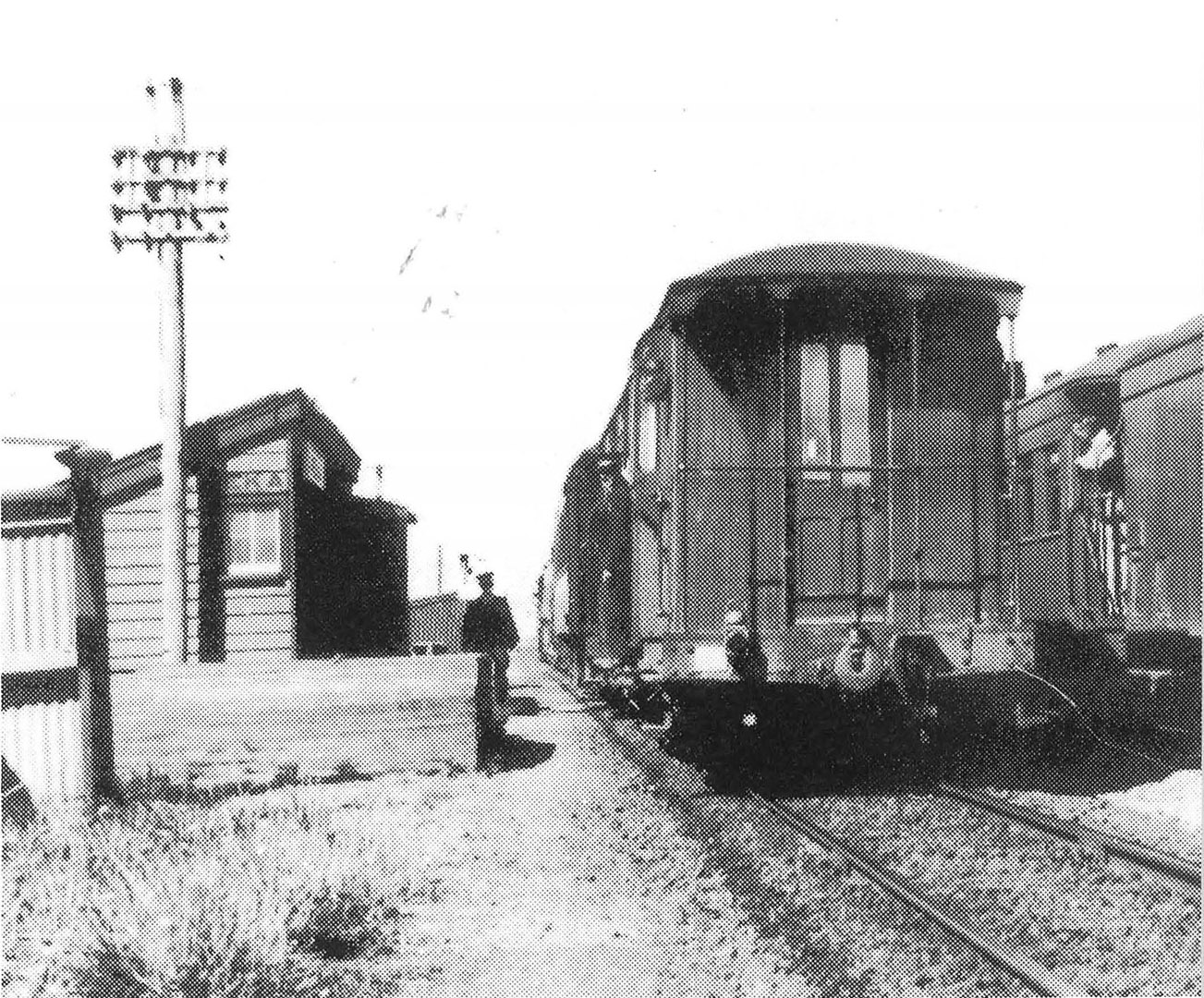 Two mixed trains crossing at Eureka. December 1949